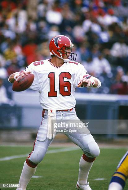 David Archer of the Atlanta Falcons drops back to pass against the Los Angeles Rams during an NFL football game October 12 1986 at AtlantaFulton...