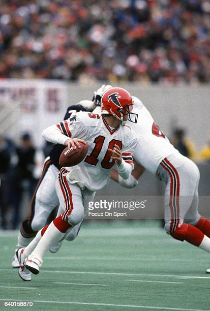 David Archer of the Atlanta Falcons rolls out to pass against the Chicago Bears during an NFL football game November 24 1985 at Soldier Field in...