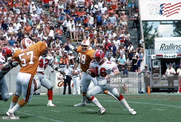 David Archer of the Atlanta Falcons scrambles with the ball against the Tampa Bay Buccaneers during an NFL football game September 13 1987 at Tampa...