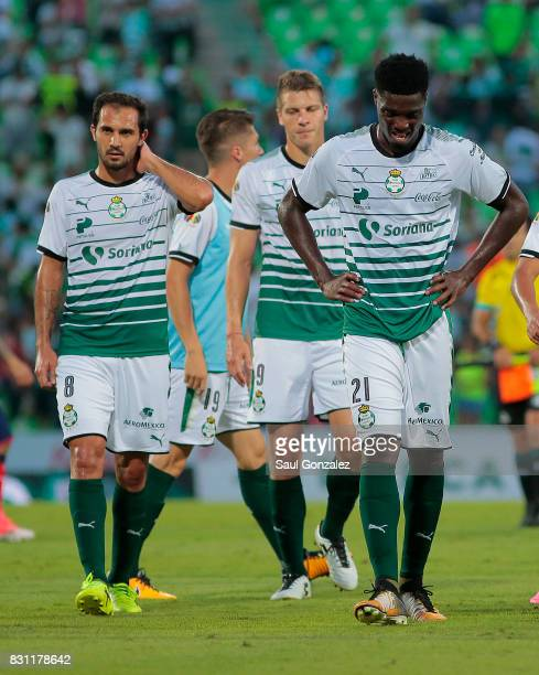 David Armenteros and Djnainy Tavares of Santos look dejected after the 4th round match between Santos Laguna and Veracruz as part of the Torneo...