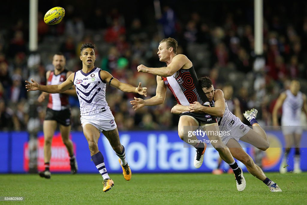 David Armitage of the Saints handballs during the round 10 AFL match between the St Kilda Saints and the Fremantle Dockers at Etihad Stadium on May 28, 2016 in Melbourne, Australia.