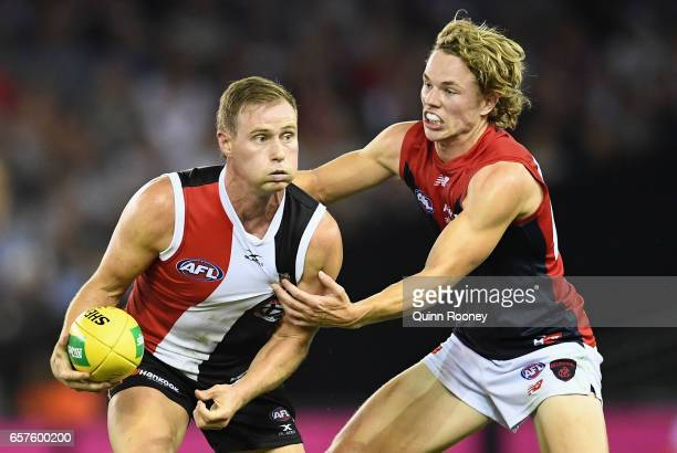 David Armitage of the Saints is tackled by Jayden Hunt of the Demons during the round one AFL match between the St Kilda Saints and the Melbourne...