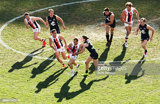 David Armitage of the Saints runs with the ball during the round 20 AFL match between the Carlton Blues and the St Kilda Saints at Melbourne Cricket...