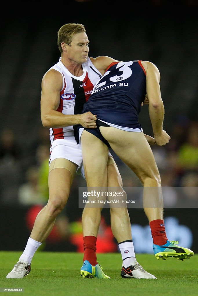 David Armitage of the Saints tackles Bernie Vince of the Demons during the round six AFL match between the Melbourne Demons and the St Kilda Saints at Etihad Stadium on April 30, 2016 in Melbourne, Australia.