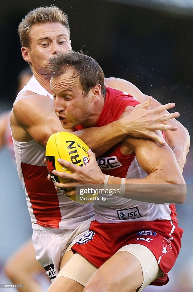David Armitage of the St.Kilda Saints tackles Jude Bolton of the Sydney Swans during the round two AFL NAB Cup match between the St Kilda Saints and the Sydney Swans at Etihad Stadium on March 3, 2013 in Melbourne, Australia.