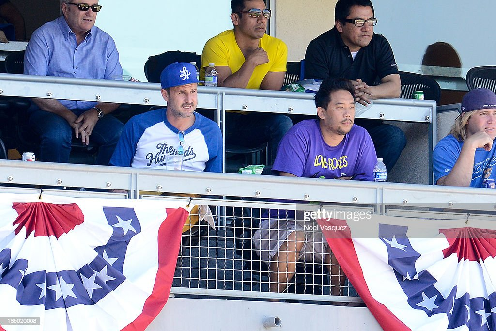 <a gi-track='captionPersonalityLinkClicked' href=/galleries/search?phrase=David+Arquette&family=editorial&specificpeople=201740 ng-click='$event.stopPropagation()'>David Arquette</a> (L) and David Choe attend Game Five of the National League Championship Series at Dodger Stadium on October 16, 2013 in Los Angeles, California.