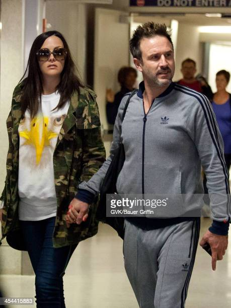 David Arquette and his girlfriend Christina McLarty are seen arriving at LAX airport on December 08 2013 in Los Angeles California