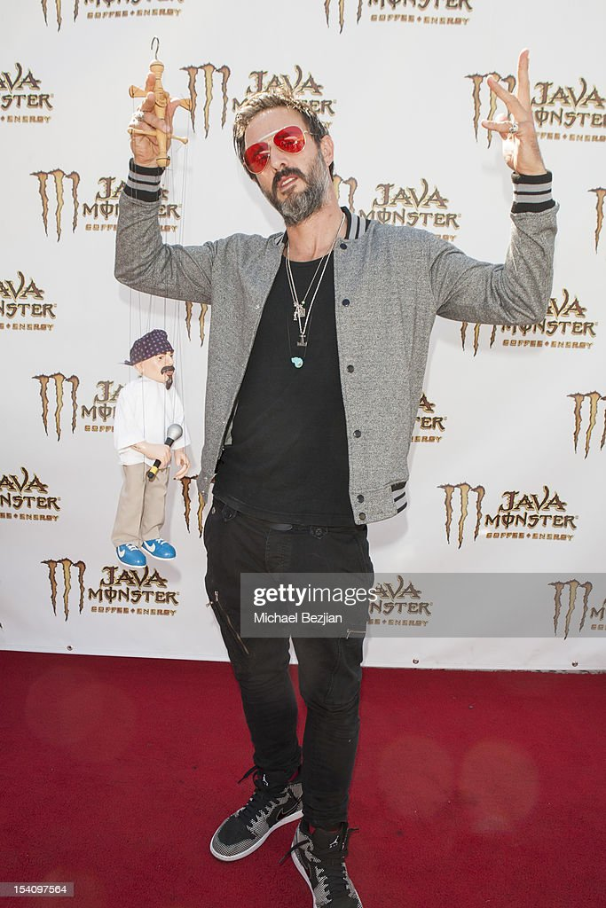 <a gi-track='captionPersonalityLinkClicked' href=/galleries/search?phrase=David+Arquette&family=editorial&specificpeople=201740 ng-click='$event.stopPropagation()'>David Arquette</a> attends <a gi-track='captionPersonalityLinkClicked' href=/galleries/search?phrase=David+Arquette&family=editorial&specificpeople=201740 ng-click='$event.stopPropagation()'>David Arquette</a>'s Piece Fest - A Music and Street Festival to benefit Pico Union Housing Corp. and Graff Lab at The Graff Lab on October 13, 2012 in Los Angeles, California.