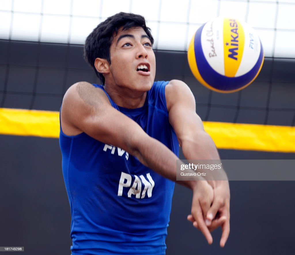 David Arrocha of Panama serves during the Men's Beach Volleyball Qualification as part of the I ODESUR South American Youth Games at Parque Tematico de los Deportes on September 24, 2013 in Lima, Peru.