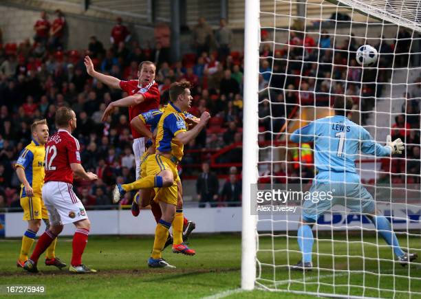David Artell of Wrexham scores the opening goal during the Blue Square Bet Premier Division Playoff SemiFinal First Leg match between Wrexham and...