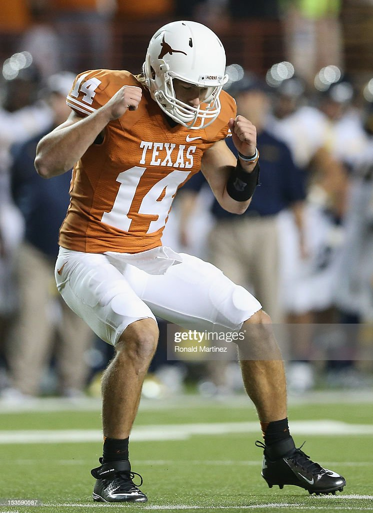 David Ash #14 of the Texas Longhorns celebrates a touchdown against the West Virginia Mountaineers at Darrell K Royal-Texas Memorial Stadium on October 6, 2012 in Austin, Texas.
