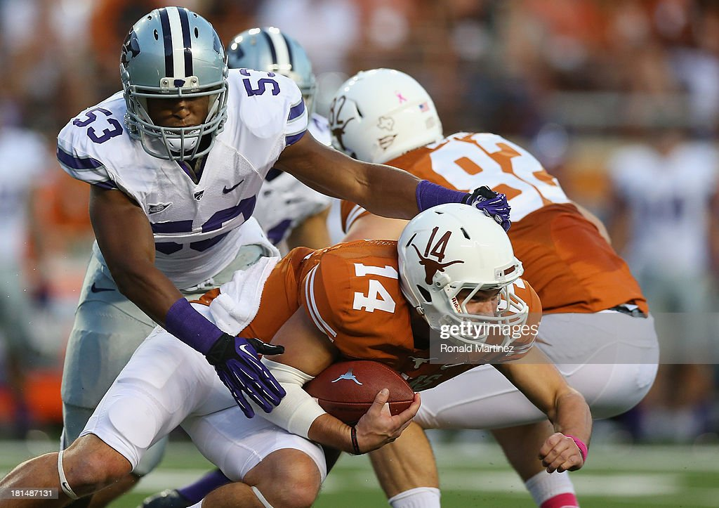 David Ash #14 of the Texas Longhorns is tackled by Blake Slaughter #53 of the Kansas State Wildcats at Darrell K Royal-Texas Memorial Stadium on September 21, 2013 in Austin, Texas.