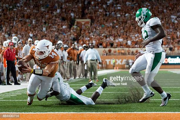 David Ash of the Texas Longhorns rushes for a 1 yard touchdown against the North Texas Mean Green during the second quarter on August 30 2014 at...