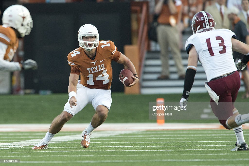 David Ash #14 of the Texas Longhorns scrambles against the New Mexico State Aggies on August 31, 2013 at Darrell K. Royal Texas Memorial Stadium in Austin, Texas.