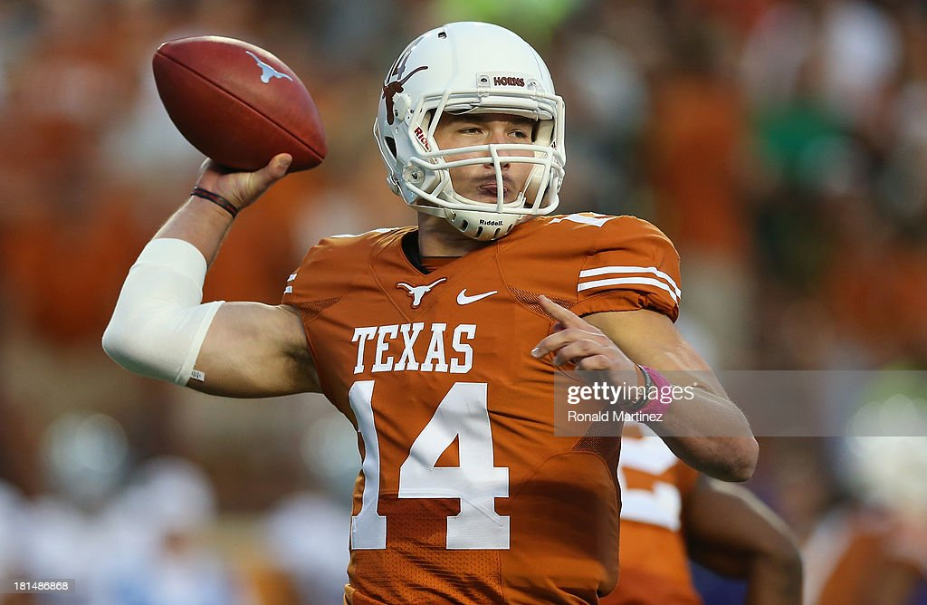 David Ash #14 of the Texas Longhorns throws against the Kansas State Wildcats at Darrell K Royal-Texas Memorial Stadium on September 21, 2013 in Austin, Texas.