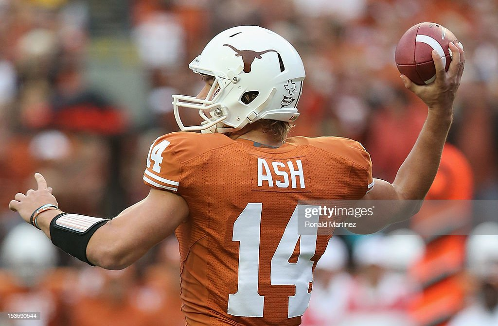 David Ash #14 of the Texas Longhorns throws the ball against the West Virginia Mountaineers at Darrell K Royal-Texas Memorial Stadium on October 6, 2012 in Austin, Texas.