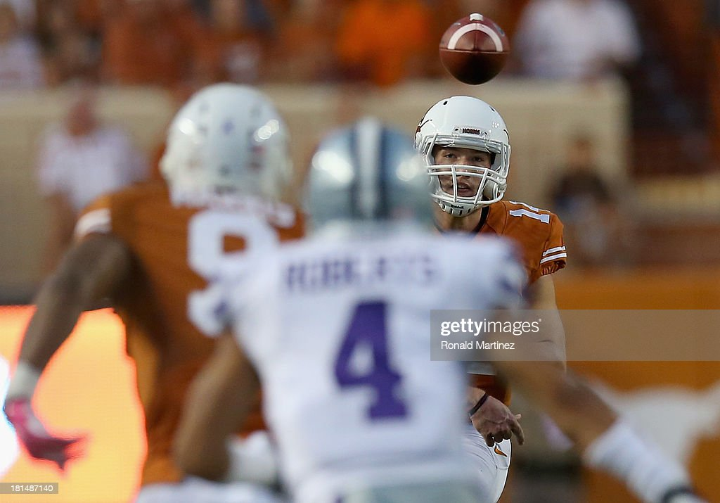 David Ash #14 of the Texas Longhorns throws to John Harris #9 of the Texas Longhorns against the Kansas State Wildcats at Darrell K Royal-Texas Memorial Stadium on September 21, 2013 in Austin, Texas.