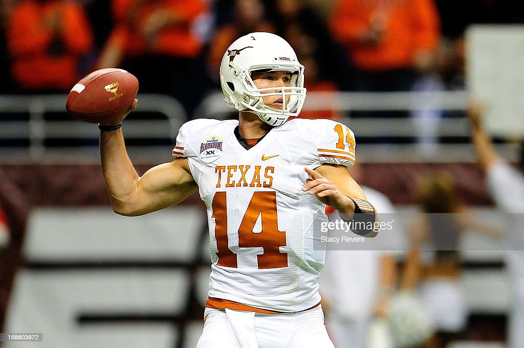 David Ash #14 of the University of Texas Longhorns drops back to pass against the Oregon State Beavers during the Valero Alamo Bowl at the Alamodome on December 29, 2012 in San Antonio, Texas. Texas won the game 31-27.