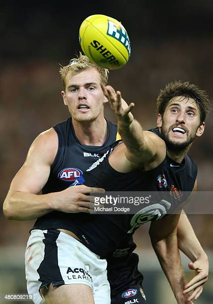 David Astbury of the Tigers and Jarrad Waite of the Blues contest for the ball during the round two AFL match between the Richmond Tigers and the...