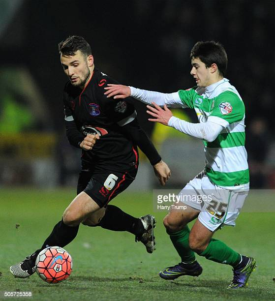 David Atkinson of Carlisle United is tackled by Liam Walsh of Yeovil Town during the Emirates FA Cup Third Round replay match between Yeovil Town and...