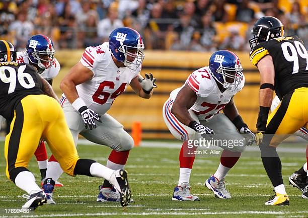 David Baas and Kevin Boothe of the New York Giants plays against the Pittsburgh Steelers during the preseason game on August 10 2013 at Heinz Field...