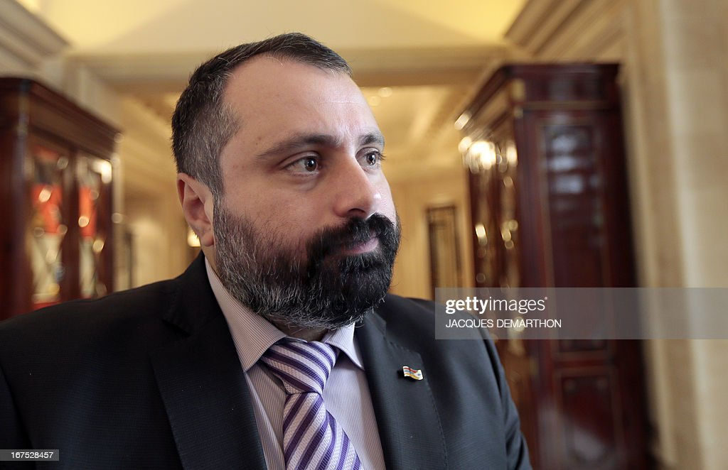 David Babaian, Communication advisor of the president of the Nagorny Karabakh region's unrecognised government, is pictured before an interview on April 26, 2013 during their three-day visit in Paris. The international community must take Azerbaijan's threats of regaining the disputed region of Nagorny Karabakh seriously and condemn Baku's ongoing arms-buying spree, the breakaway territory's leader said Friday. AFP PHOTO/JACQUES DEMARTHON