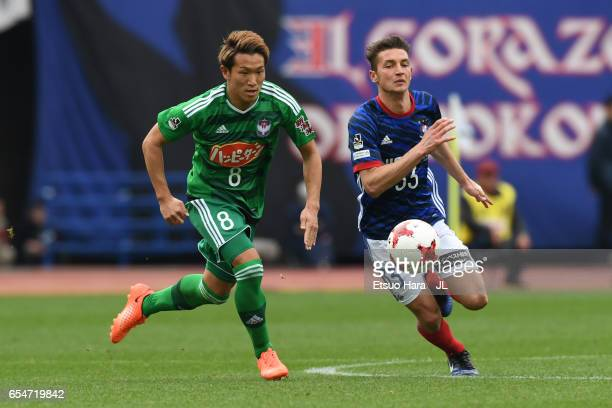 David Babunski of Yokohama FMarinos and Kei Koizumi of Albirex Niigata compete for the ball during the JLeague J1 match between Yokohama FMarinos and...