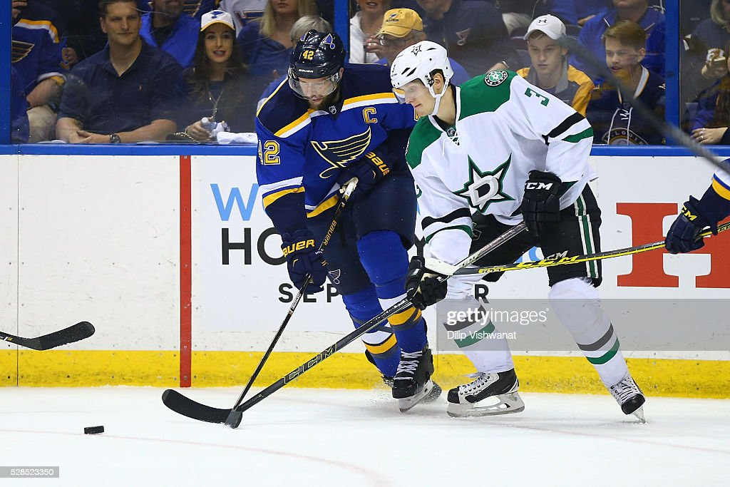 <a gi-track='captionPersonalityLinkClicked' href=/galleries/search?phrase=David+Backes&family=editorial&specificpeople=2538492 ng-click='$event.stopPropagation()'>David Backes</a> #42 of the St. Louis Blues and <a gi-track='captionPersonalityLinkClicked' href=/galleries/search?phrase=John+Klingberg&family=editorial&specificpeople=7418652 ng-click='$event.stopPropagation()'>John Klingberg</a> #3 of the Dallas Stars fight for control of the puck in Game Four of the Western Conference Second Round during the 2016 NHL Stanley Cup Playoffs at the Scottrade Center on May 5, 2016 in St. Louis, Missouri.