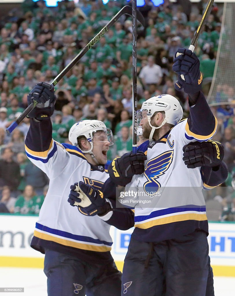 David Backes #42 of the St. Louis Blues and Vladimir Tarasenko #91 of the St. Louis Blues celebrate after Backes scored the game winning goal against Antti Niemi #31 of the Dallas Stars in overtime in Game Two of the Western Conference Second Round during the 2016 NHL Stanley Cup Playoffs at American Airlines Center on May 1, 2016 in Dallas, Texas.