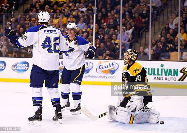 David Backes of the St Louis Blues celebrates his goal in the second period with teammate Alexander Steen in front of Tuukka Rask of the Boston...