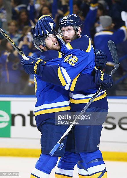 David Backes of the St Louis Blues celebrates with Jaden Schwartz after scoring a first period goal against Martin Jones of the San Jose Sharks in...