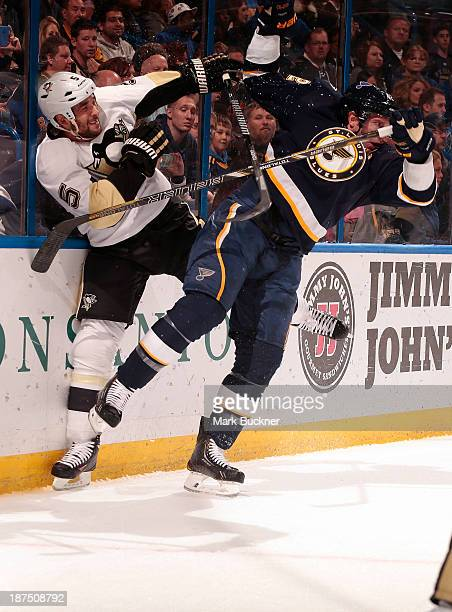 David Backes of the St Louis Blues checks Deryk Engelland of the Pittsburgh Penguins on November 9 2013 at Scottrade Center in St Louis Missouri