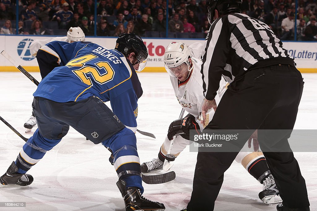 <a gi-track='captionPersonalityLinkClicked' href=/galleries/search?phrase=David+Backes&family=editorial&specificpeople=2538492 ng-click='$event.stopPropagation()'>David Backes</a> #42 of the St. Louis Blues faces off against <a gi-track='captionPersonalityLinkClicked' href=/galleries/search?phrase=Saku+Koivu&family=editorial&specificpeople=202253 ng-click='$event.stopPropagation()'>Saku Koivu</a> #11 of the Anaheim Ducks in an NHL game on March 16, 2013 at Scottrade Center in St. Louis, Missouri.