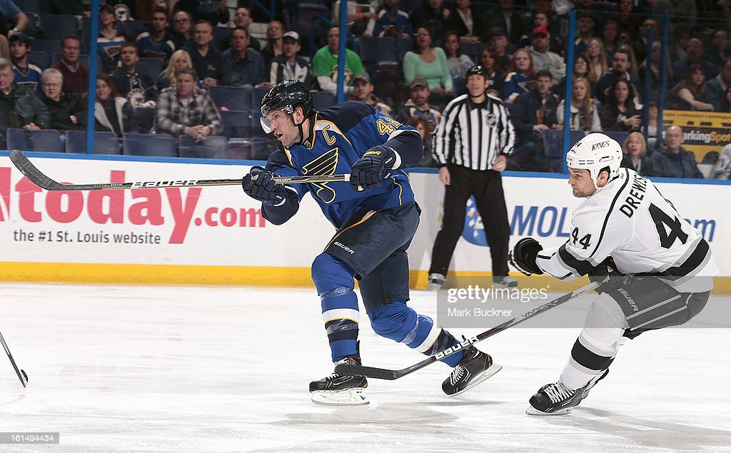 David Backes #42 of the St. Louis Blues forest the puck as Davis Drewiske #44 defends in an NHL game on February 11, 2013 at Scottrade Center in St. Louis, Missouri.