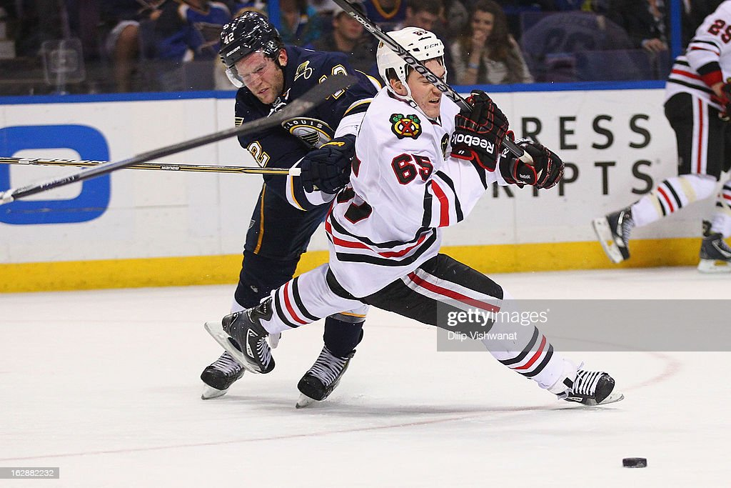 <a gi-track='captionPersonalityLinkClicked' href=/galleries/search?phrase=David+Backes&family=editorial&specificpeople=2538492 ng-click='$event.stopPropagation()'>David Backes</a> #42 of the St. Louis Blues knocks Andrew Shaw #65 of the Chicago Blackhawks off the puck at the Scottrade Center on February 28, 2013 in St. Louis, Missouri.