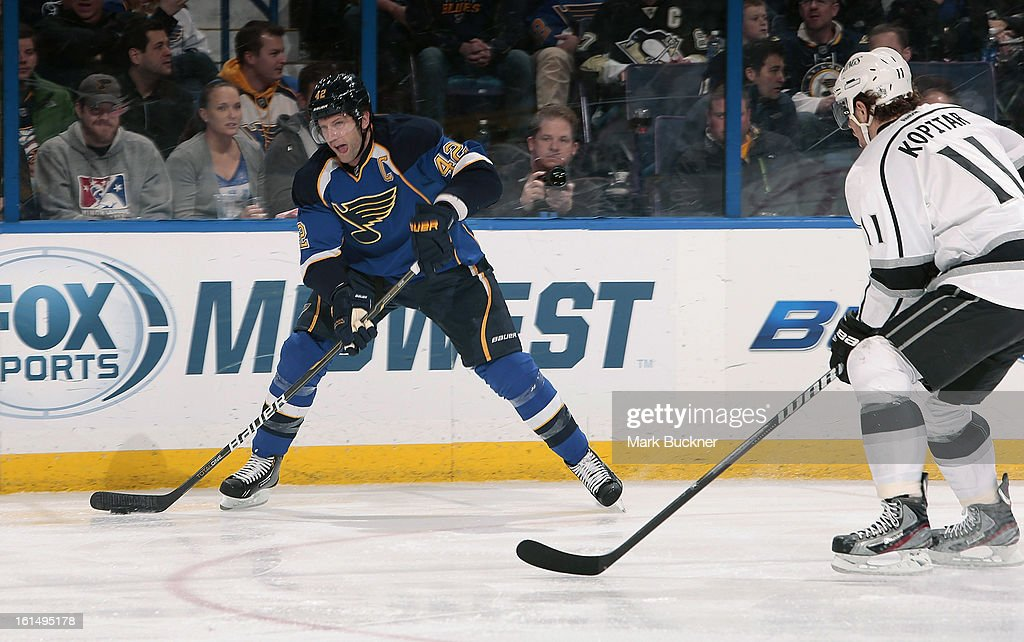 <a gi-track='captionPersonalityLinkClicked' href=/galleries/search?phrase=David+Backes&family=editorial&specificpeople=2538492 ng-click='$event.stopPropagation()'>David Backes</a> #42 of the St. Louis Blues looks to pass the puck away from <a gi-track='captionPersonalityLinkClicked' href=/galleries/search?phrase=Anze+Kopitar&family=editorial&specificpeople=634911 ng-click='$event.stopPropagation()'>Anze Kopitar</a> #11 of the Anaheim Ducks in an NHL game on February 11, 2013 at Scottrade Center in St. Louis, Missouri.