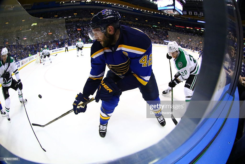<a gi-track='captionPersonalityLinkClicked' href=/galleries/search?phrase=David+Backes&family=editorial&specificpeople=2538492 ng-click='$event.stopPropagation()'>David Backes</a> #42 of the St. Louis Blues passes the puck against the Dallas Stars in Game Four of the Western Conference Second Round during the 2016 NHL Stanley Cup Playoffs at the Scottrade Center on May 5, 2016 in St. Louis, Missouri.