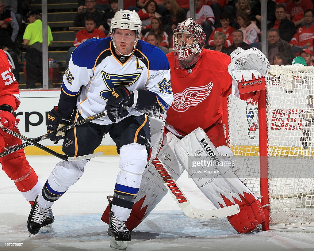 David Backes #42 of the St Louis Blues skates in front of Jimmy Howard #35 of the Detroit Red Wings during an NHL game at Joe Louis Arena on April 7, 2013 in Detroit, Michigan. The Blues won 1-0