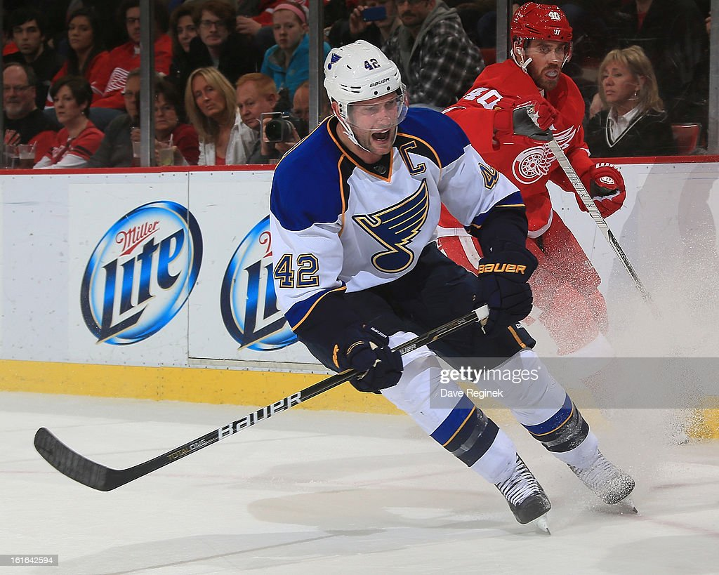 <a gi-track='captionPersonalityLinkClicked' href=/galleries/search?phrase=David+Backes&family=editorial&specificpeople=2538492 ng-click='$event.stopPropagation()'>David Backes</a> #42 of the St Louis Blues stops in the corner during a NHL game against the Detroit Red Wings at Joe Louis Arena on February 13, 2013 in Detroit, Michigan.