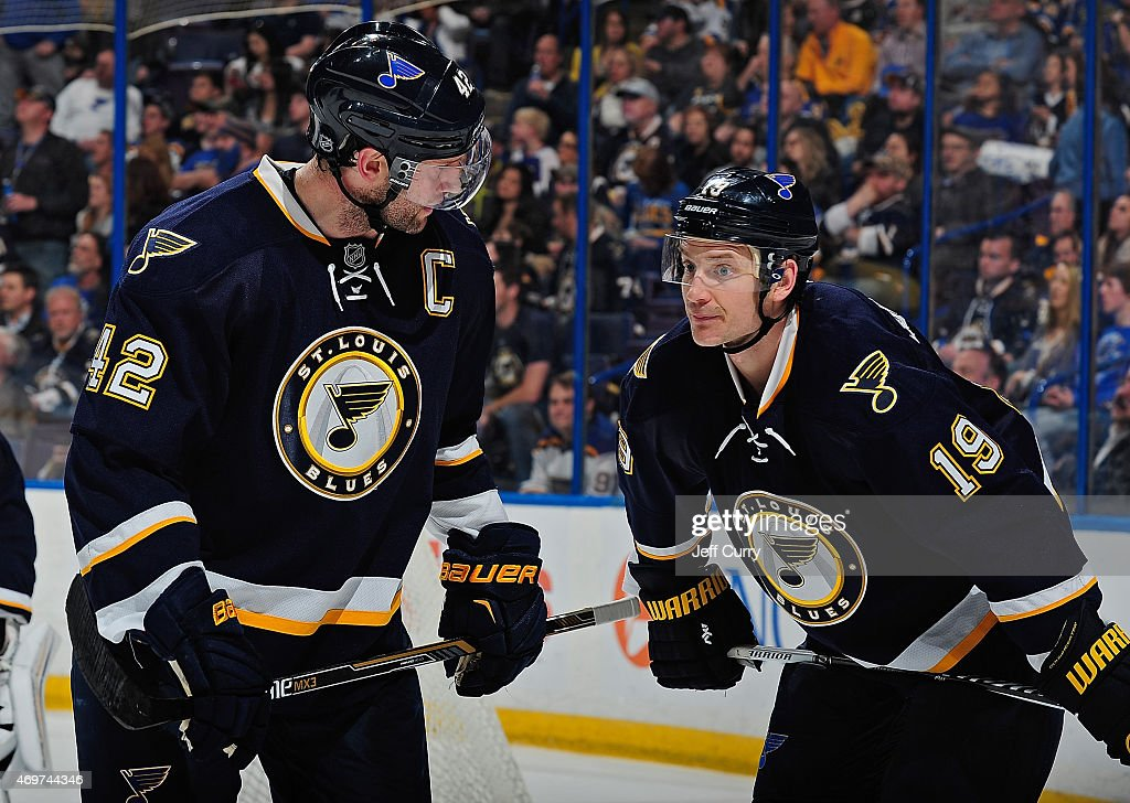David Backes of the St Louis Blues talks with Jay Bouwmeester during a game against the Winnipeg Jets on April 7 2015 at the Scottrade Center in St...