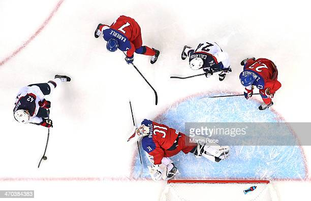 David Backes of the United States scores his team's third goal in the first period against Ondrej Pavelec of the Czech Republic during the Men's Ice...