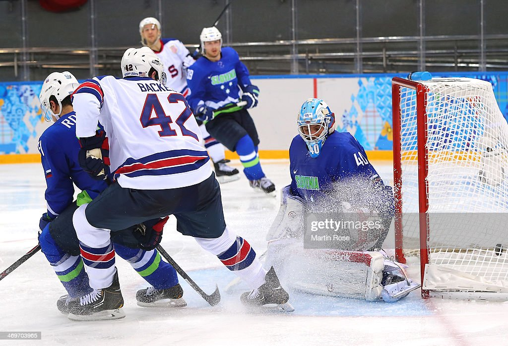 <a gi-track='captionPersonalityLinkClicked' href=/galleries/search?phrase=David+Backes&family=editorial&specificpeople=2538492 ng-click='$event.stopPropagation()'>David Backes</a> #42 of the United States shoots and scores against Luka Gracnar #40 of Slovenia in the third period during the Men's Ice Hockey Preliminary Round Group A game on day nine of the Sochi 2014 Winter Olympics at Shayba Arena on February 16, 2014 in Sochi, Russia.