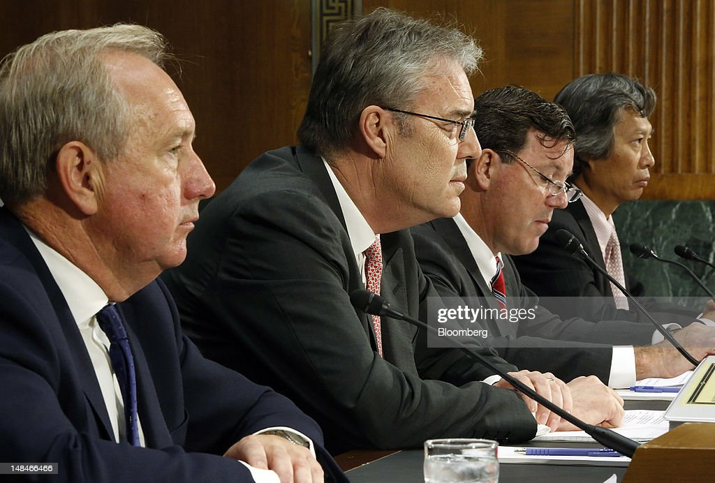 David Bagley, head of group compliance for HSBC Holdings Plc,, from left, Paul Thurston, chief executive officer of retail banking and wealth management for HSBC, Michael Gallagher, former executive vice president and head of PCM North America for HSBC Bank USA, and Christopher Lok, former head of global banknotes for HSBC Bank USA, testify at a hearing of the U.S. Senate Homeland Security and Governmental Affairs Committee's Permanent Subcommittee on Investigations, in Washington, D.C., U.S., on Tuesday, July 17, 2012. London-based HSBC enabled drug lords to launder money in Mexico, did business with firms linked to terrorism and concealed transactions that bypassed U.S. sanctions against Iran, Senate investigators said in a report. Photographer: Jonathan Ernst/Bloomberg via Getty Images