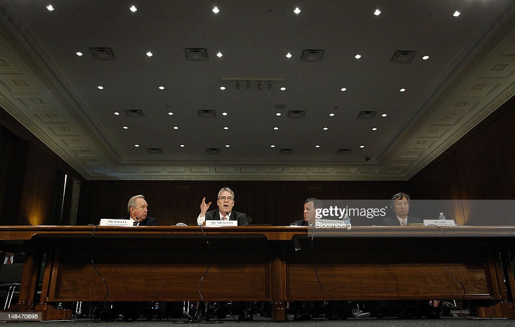 David Bagley, head of group compliance for HSBC Holdings Plc, from left, Paul Thurston, chief executive officer of retail banking and wealth management for HSBC, Michael Gallagher, former executive vice president and head of PCM North America for HSBC Bank USA, and Christopher Lok, former head of global banknotes for HSBC Bank USA, testify at a hearing of the U.S. Senate Homeland Security and Governmental Affairs Committee's Permanent Subcommittee on Investigations in Washington, D.C., U.S., on Tuesday, July 17, 2012. London-based HSBC enabled drug lords to launder money in Mexico, did business with firms linked to terrorism and concealed transactions that bypassed U.S. sanctions against Iran, Senate investigators said in a report. Photographer: Jonathan Ernst/Bloomberg via Getty Images