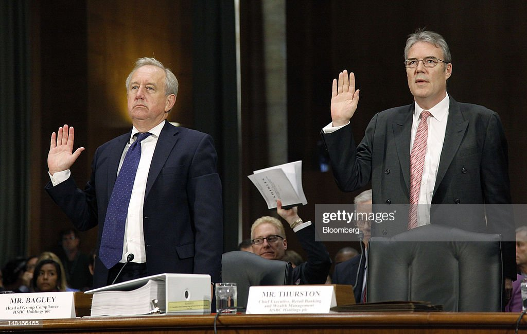 David Bagley, head of group compliance for HSBC Holdings Plc, left, and Paul Thurston, chief executive officer of retail banking and wealth management for HSBC, are sworn in to testify at a hearing of the U.S. Senate Homeland Security and Governmental Affairs Committee's Permanent Subcommittee on Investigations, in Washington, D.C., U.S., on Tuesday, July 17, 2012. Jonathan Ernst/Bloomberg via Getty Images