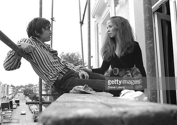 David Bailey one of the world's leading fashion photographers with his girlfriend model Penelope Tree London circa 1965