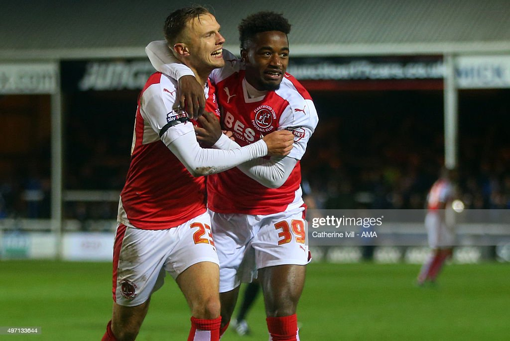 David Ball of Fleetwood Town celebrates after scoring to make it 1-1 with Tariqe Fosu of Fleetwood Town during the Sky Bet League One match between Peterborough United and Fleetwood Town at London Road Stadium on November 14, 2015 in Peterborough, England.