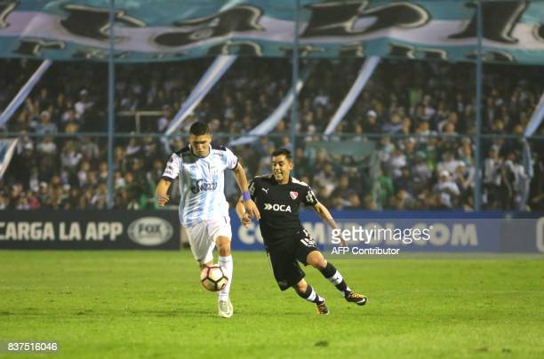 David Barbona of Atletico Tucuman disputes the ball with Diego Rodriguez of Independiente in their Copa Sudamericana 2017 match in the Jose Fierro...