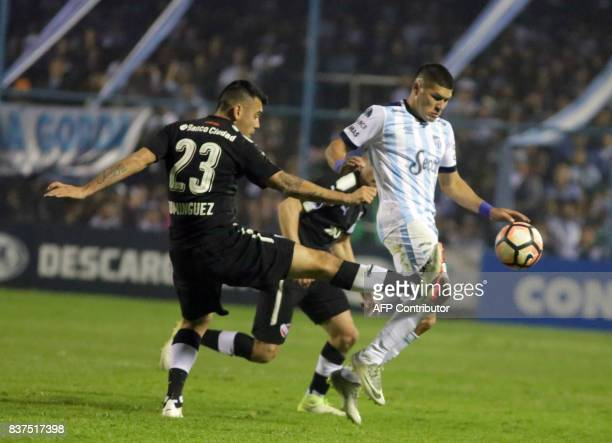 David Barbona of Atletico Tucuman disputes the ball with Nery Dominguez of Independiente in their Copa Sudamericana 2017 match in the Jose Fierro...