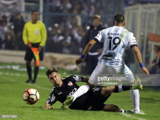 David Barbona of Atletico Tucuman disputes the ball with Nicolas Tagliafico of Independiente in their Copa Sudamericana match at the Jose Fierro...